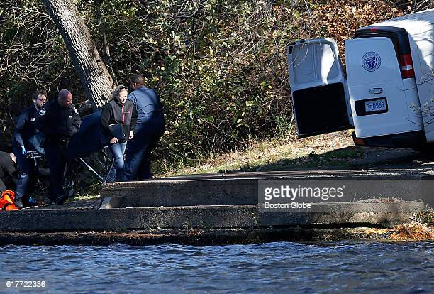 Officials remove a body found in the Merrimack River in Tyngsborough Mass Oct 23 2016