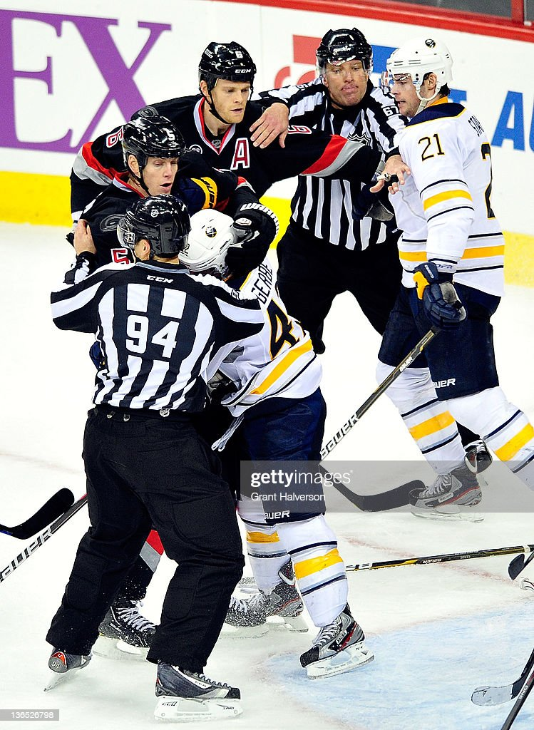 Officials separate <a gi-track='captionPersonalityLinkClicked' href=/galleries/search?phrase=Nathan+Gerbe&family=editorial&specificpeople=697084 ng-click='$event.stopPropagation()'>Nathan Gerbe</a> #42 and <a gi-track='captionPersonalityLinkClicked' href=/galleries/search?phrase=Drew+Stafford&family=editorial&specificpeople=220617 ng-click='$event.stopPropagation()'>Drew Stafford</a> #21 of the Buffalo Sabres from <a gi-track='captionPersonalityLinkClicked' href=/galleries/search?phrase=Bryan+Allen+-+Ice+Hockey+Player&family=editorial&specificpeople=206454 ng-click='$event.stopPropagation()'>Bryan Allen</a> #5 and <a gi-track='captionPersonalityLinkClicked' href=/galleries/search?phrase=Tim+Gleason&family=editorial&specificpeople=211575 ng-click='$event.stopPropagation()'>Tim Gleason</a> #6 of the Carolina Hurricanes as they fight during play at the RBC Center on January 6, 2012 in Raleigh, North Carolina. The Hurricanes won 4-2.