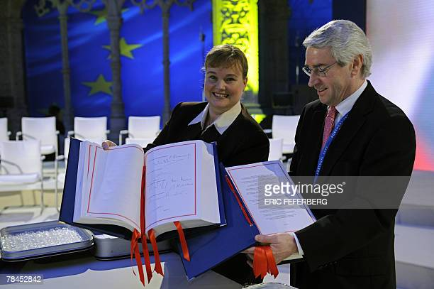 Officials show the Lisbon treaty book signed by French President Nicols Sarkozy and EU leaders in Jeronimos monastery in Lisbon 13 December 2007 The...