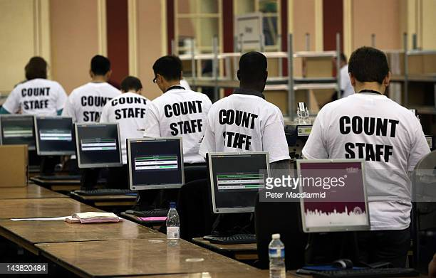 Officials stand at vote counting machines at the London Mayoral and London Assembly counting centre at Alexandra Palace on May 4 2012 in London...
