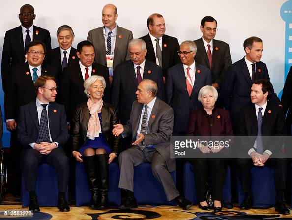 Officials take their positions a family photo of G20 Finance Ministers and Central Bank Governors Meeting at the Pudong Shangrila Hotel on February...