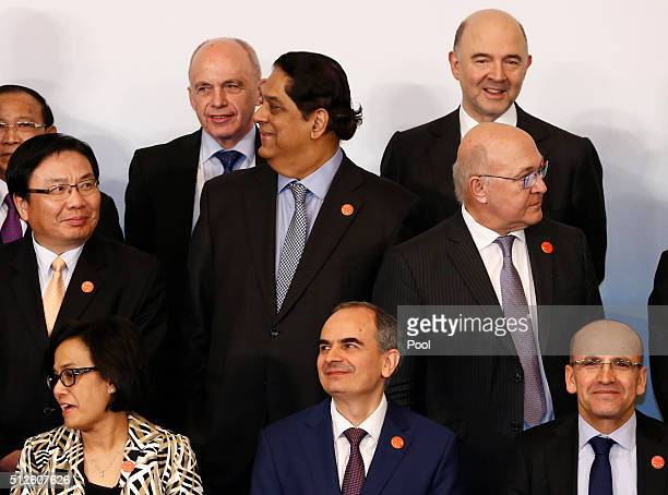 Officials take their positions for a family photo of G20 Finance Ministers and Central Bank Governors Meeting at the Pudong Shangrila Hotel on...