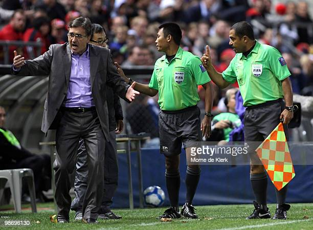 Officials talk to Shandong coach Branco Ivankovic during the AFC Champions League Group H match between Adelaide United and Shandong Luneng at...