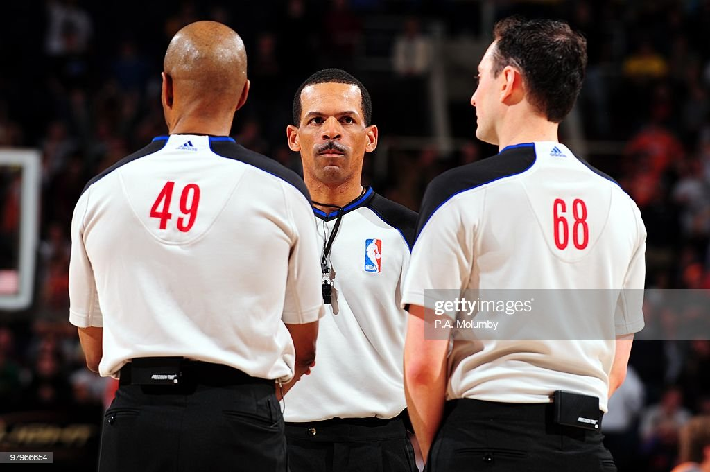 NBA officials Tom Washington Eric Lewis and Marat Kogut huddle on the court during the game between the Utah Jazz and the Phoenix Suns at US Airways...
