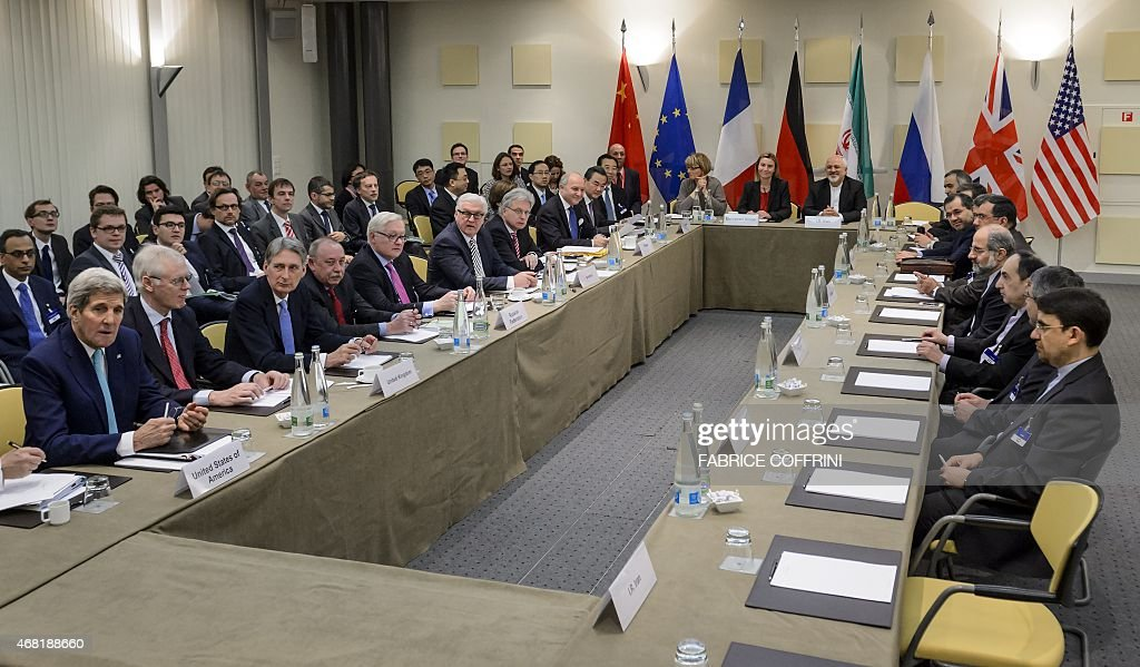 Officials wait for a meeting with officials from P51 the European Union and Iran ahead of the opening of a plenary session on Iran nuclear talks at...
