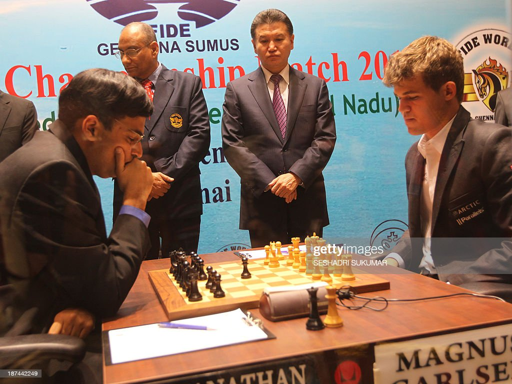 Officials watch as India's Viswanathan Anand (L) and Norway's Magnus Carlsen (R) compete in their championship match in Chennai on November 9, 2013. Reigning world chess champion Viswanathan Anand is defending his crown against Norwegian sensation Magnus Carlsen at home in Chennai in a battle that favours the challenger. AFP PHOTO/SESHADRI SUKUMAR