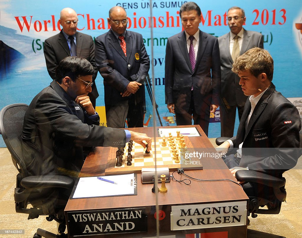 Officials watch as India's Viswanathan Anand (L) and Norway's Magnus Carlsen (R) compete in their championship match in Chennai on November 9, 2013. Reigning world chess champion Viswanathan Anand is defending his crown against Norwegian sensation Magnus Carlsen at home in Chennai in a battle that favours the challenger.