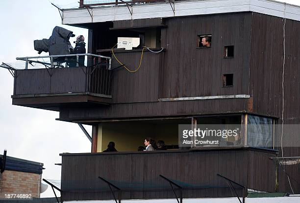 Officials watch the race from their vantage point at Huntingdon racecourse on November 12 2013 in Huntingdon England