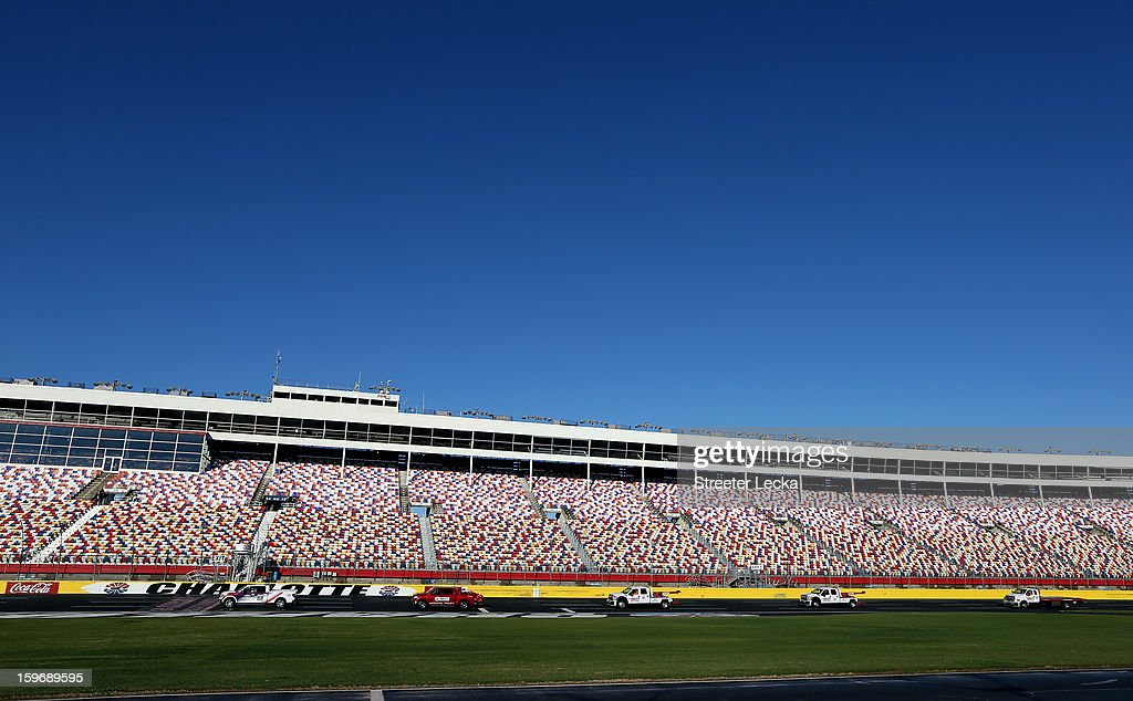 Officials work to dry the track before NASCAR Testing at Charlotte Motor Speedway on January 18, 2013 in Charlotte, North Carolina.