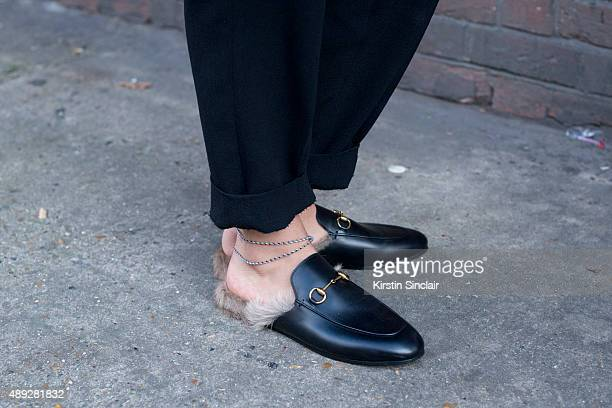 Officiel Middle East Creative Director Melanie Dagher wears Gucci shoes and Celine trousers on day 2 during London Fashion Week Spring/Summer 2016/17...