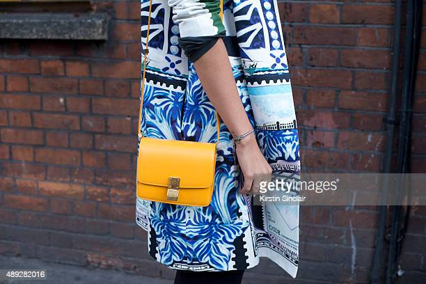 Officiel Middle East Creative Director Melanie Dagher wears Mary Katrantzou coat Celine bag Gucci shoes Mykita sunglasses and Celine trousers on day...