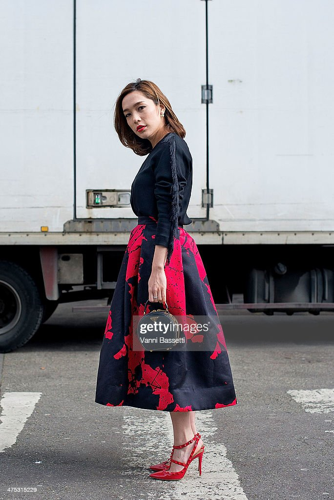 L'Officiel Thailand fashion director May Buranasiri wears a TB skirt, Prada bag and Valentino shoes before Dries Van Noten Show at the Hotel de Ville on February 26, 2014 in Paris, France.