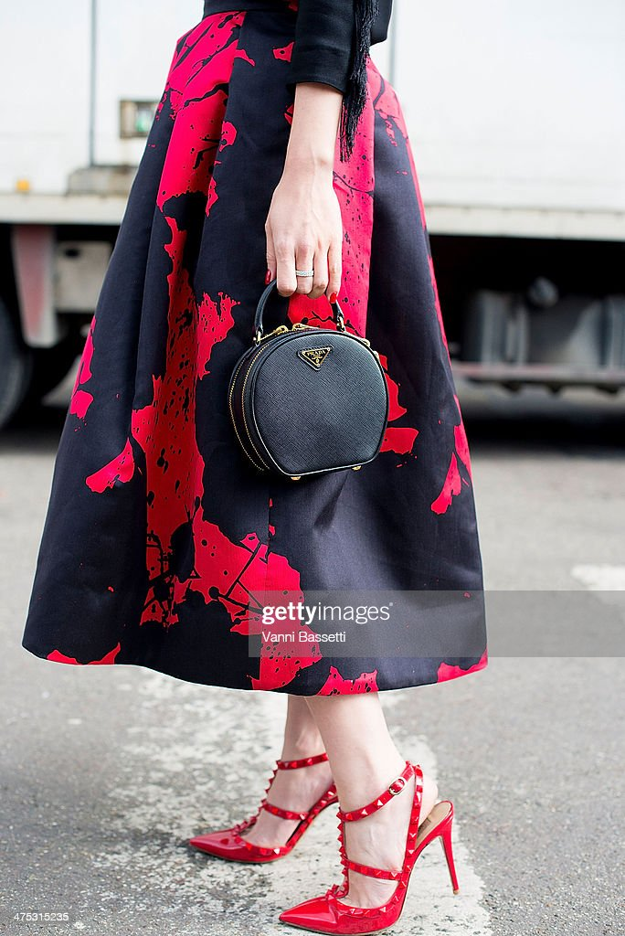 Officiel Thailand fashion director May Buranasiri wears a TB skirt Prada bag and Valentino shoes before Dries Van Noten Show at the Hotel de Ville on...