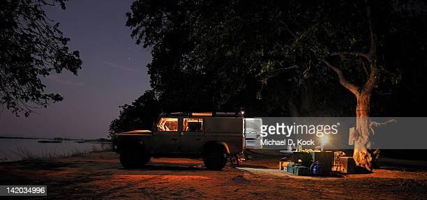Off-road car and evening campsite alongside the Zambezi River, Mana Pools, Zambezi Valley, Zimbabwe