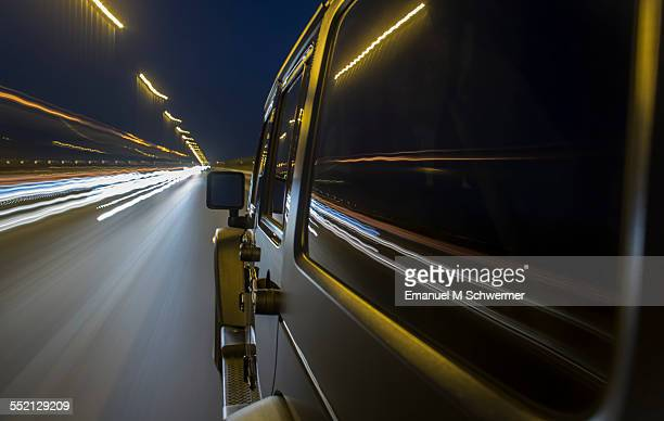 off-road car drives on a highway during night