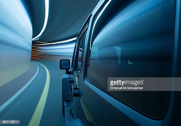 off-road car drives through a tunnel
