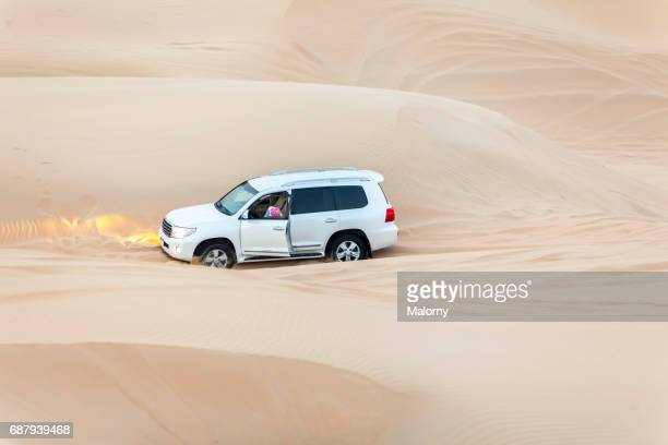 Off-road or 4x4 vehicle got stuck in the sand on a trip in the desert