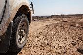 Offroad truck wheel on dirt road