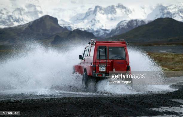 Off-Road Vehicle Crossing River in Iceland