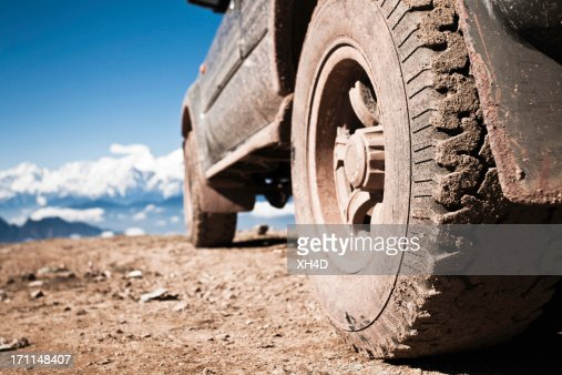 off-road vehicle on mountain peak