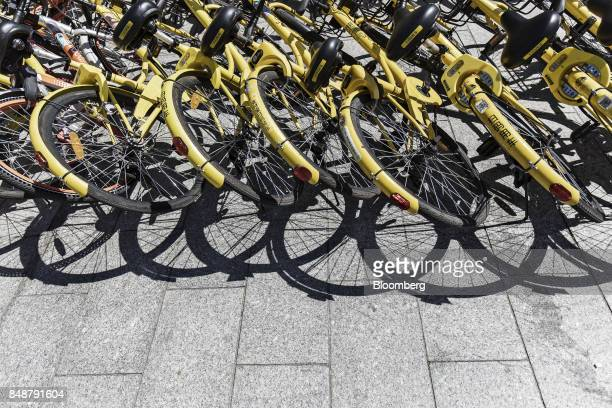 Ofo Inc bicycles lie on a sidewalk outside a subway station in Shanghai China on Thursday Sept 12 2017 Across Chinese cities sidewalks are filling up...