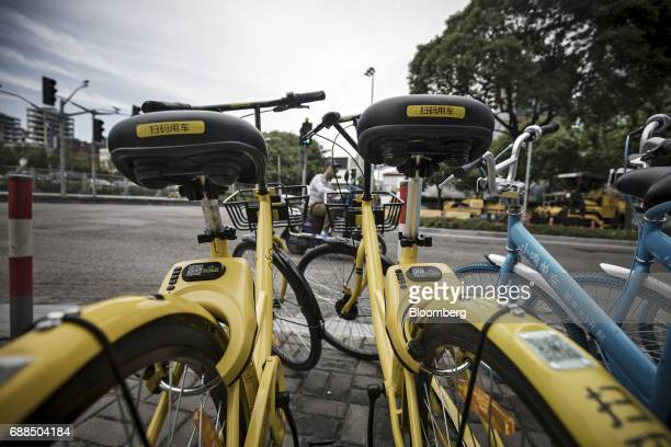 Ofo Inc bicycles sit parked on a sidewalk in Shanghai China on Thursday May 25 2017 In China a bicyclesharing phenomenon is changing the way urban...