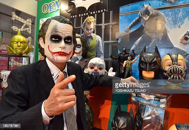 Ogawa Rubber Japan's top rubber mask maker employee wearing a rubber mask of Joker shows masks of Batman movie characters at the Tokyo International...