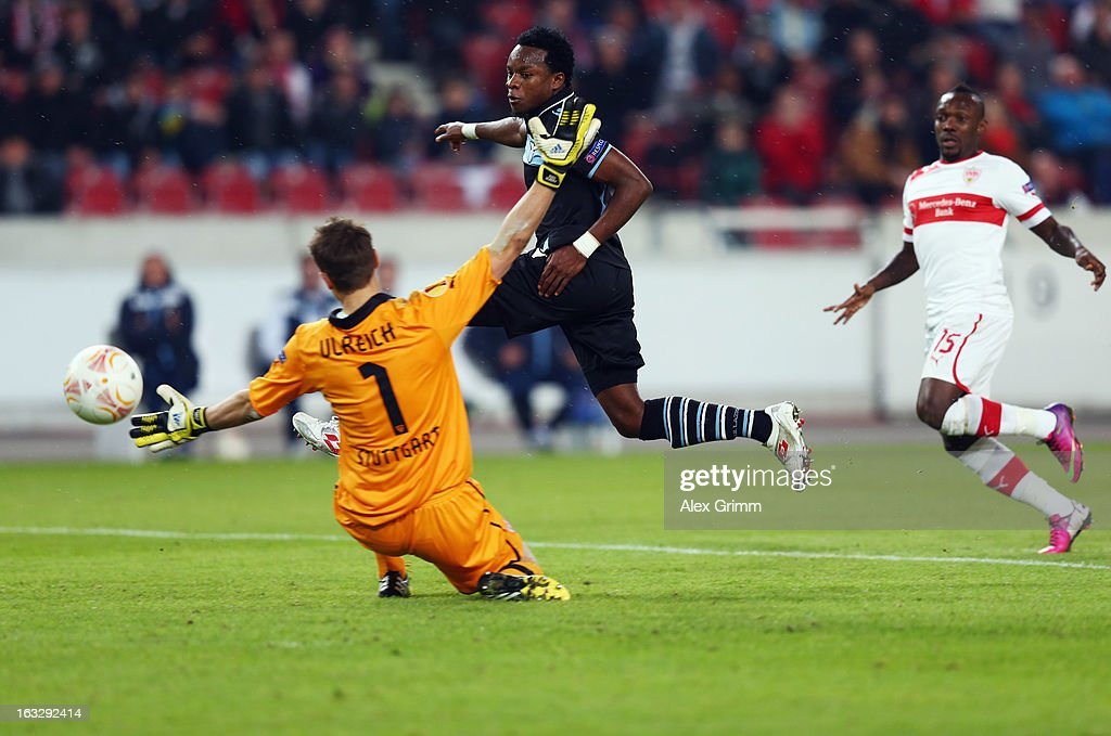 Ogenyi Onazi of Lazio scores his team's second goal against goalkeeper <a gi-track='captionPersonalityLinkClicked' href=/galleries/search?phrase=Sven+Ulreich&family=editorial&specificpeople=4877030 ng-click='$event.stopPropagation()'>Sven Ulreich</a> and <a gi-track='captionPersonalityLinkClicked' href=/galleries/search?phrase=Arthur+Boka&family=editorial&specificpeople=550855 ng-click='$event.stopPropagation()'>Arthur Boka</a> of Stuttgart during the UEFA Europa League round of 16 first leg match between VfB Stuttgart and Lazio at Mercedes-Benz Arena on March 7, 2013 in Stuttgart, Germany.