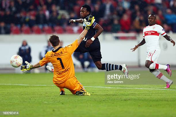 Ogenyi Onazi of Lazio scores his team's second goal against goalkeeper Sven Ulreich and Arthur Boka of Stuttgart during the UEFA Europa League round...