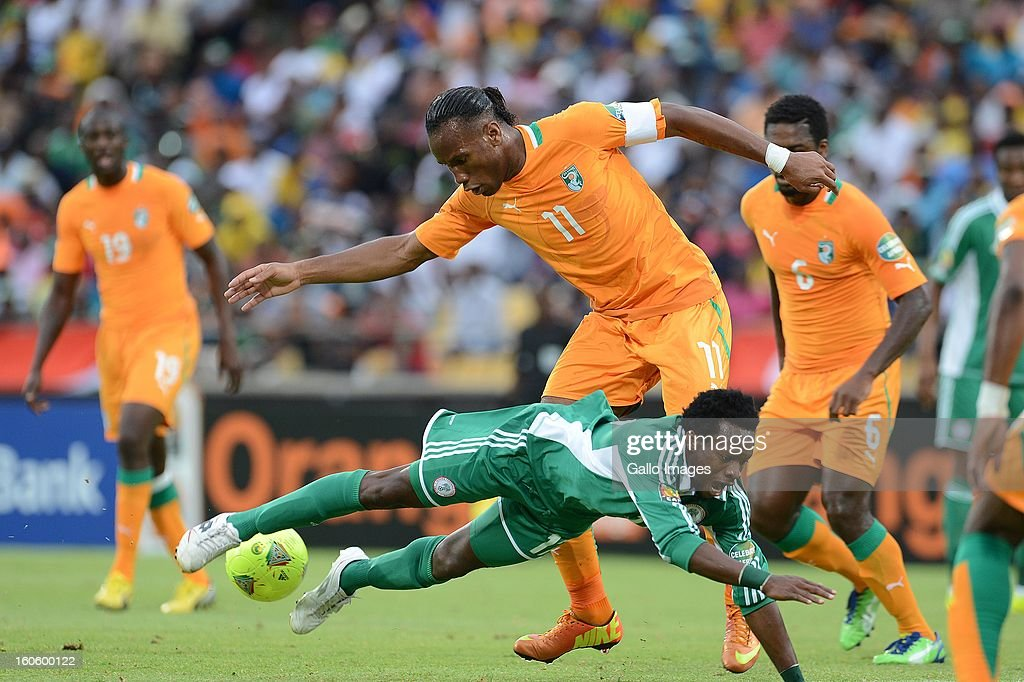 Ogenyi Onazi of Nigeria and <a gi-track='captionPersonalityLinkClicked' href=/galleries/search?phrase=Didier+Drogba&family=editorial&specificpeople=179398 ng-click='$event.stopPropagation()'>Didier Drogba</a> of Ivory Coast compete during the 2013 Orange African Cup of Nations 3rd Quarter Final match between Ivory Coast and Nigeria, at Royal Bafokeng Stadium on February 03, 2013 in Rustenburg, South Africa.