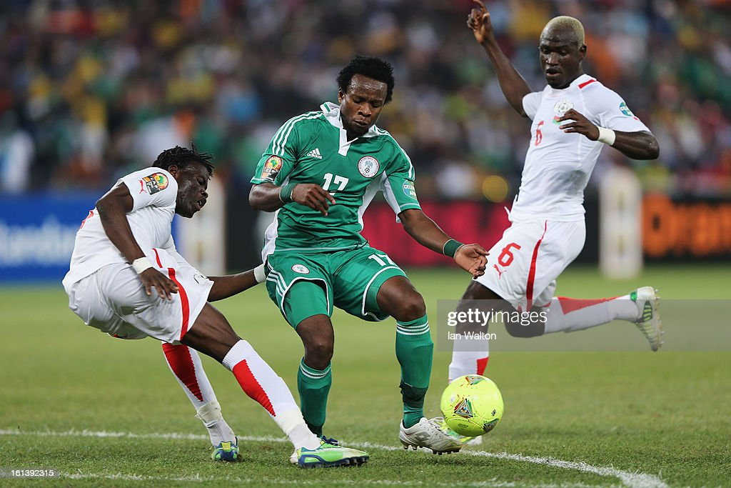Ogenyi Onazi of Nigeria is tackled by Djakaridja Kone of Burkina Faso during the 2013 Africa Cup of Nations Final match between Nigeria and Burkina at FNB Stadium on February 10, 2013 in Johannesburg, South Africa.