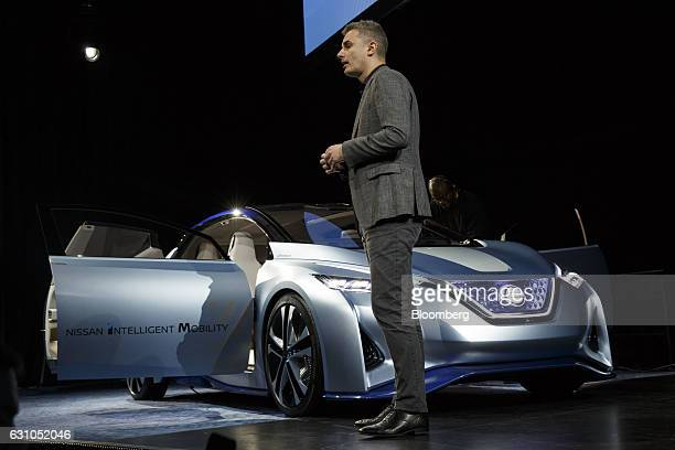 Ogi Redzic senior vice president for connected vehicles at the RenaultNissan Alliance stands next to the Nissan Motor Co Intelligent Mobility IDS...