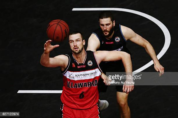 Ogilvy of the Hawks competes against Alex Pledger of the Breakers during the round nine NBL match between the New Zealand Breakers and Illawarra...
