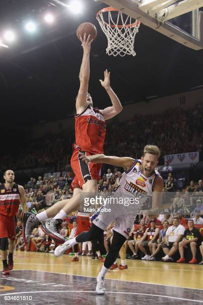 J Ogilvy of the Hawks drives to the basket over Mitchell Young of the Bullets during the round 19 NBL match between the Illawarra Hawks and the...