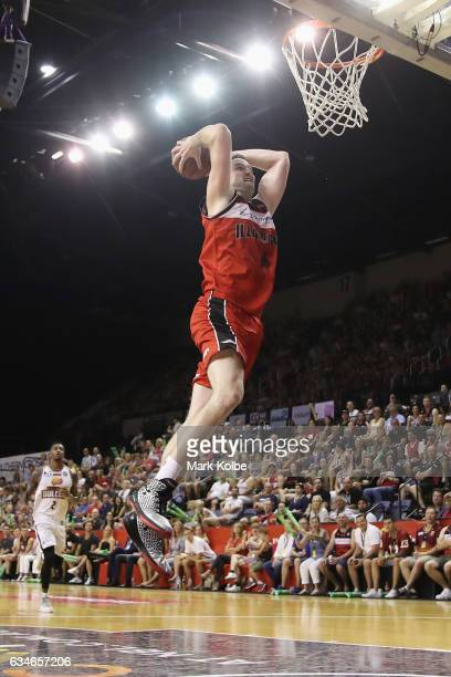 J Ogilvy of the Hawks dunks during the round 19 NBL match between the Illawarra Hawks and the Brisbane Bullets at Wollongong Entertainment Centre on...