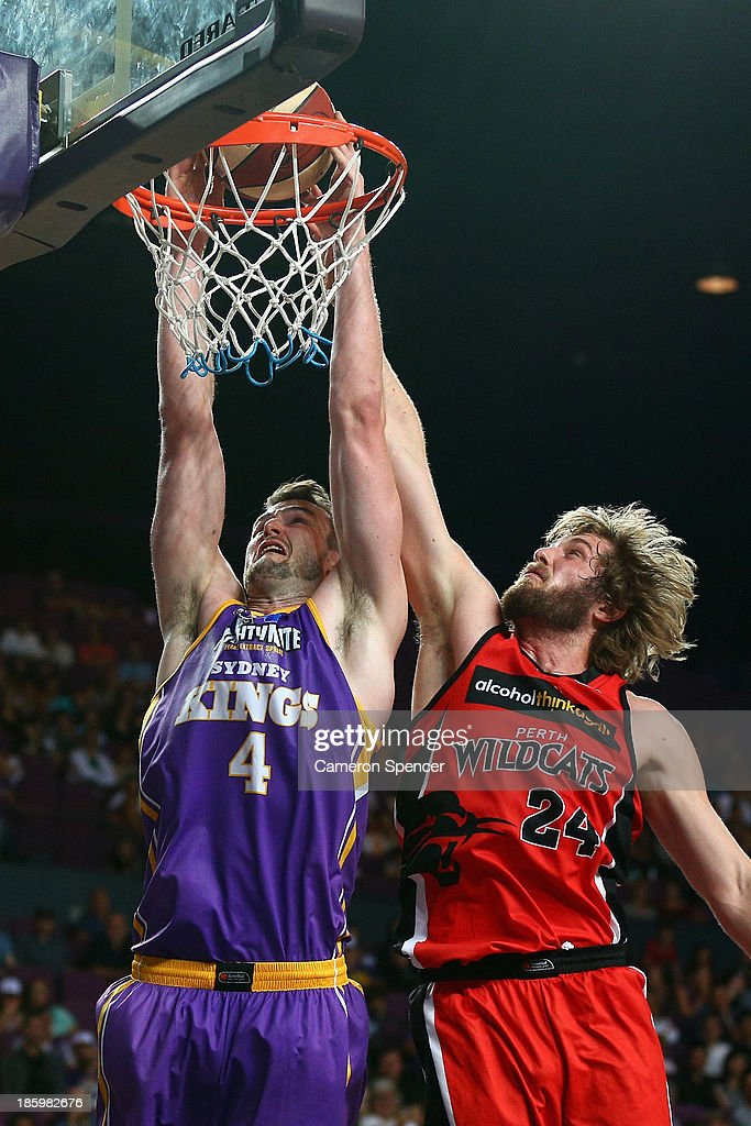 AJ Ogilvy of the Kings slam dunks during the round three NBL match between the Sydney Kings and the Perth Wildcats at Sydney Entertainment Centre in October 27, 2013 in Sydney, Australia.