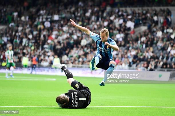 Ogmundur Kristinsson goalkeeperof Hammarby IF against Gustav Engvall of Djurgardens IF during the Allsvenskan match between Hammarby IF and...