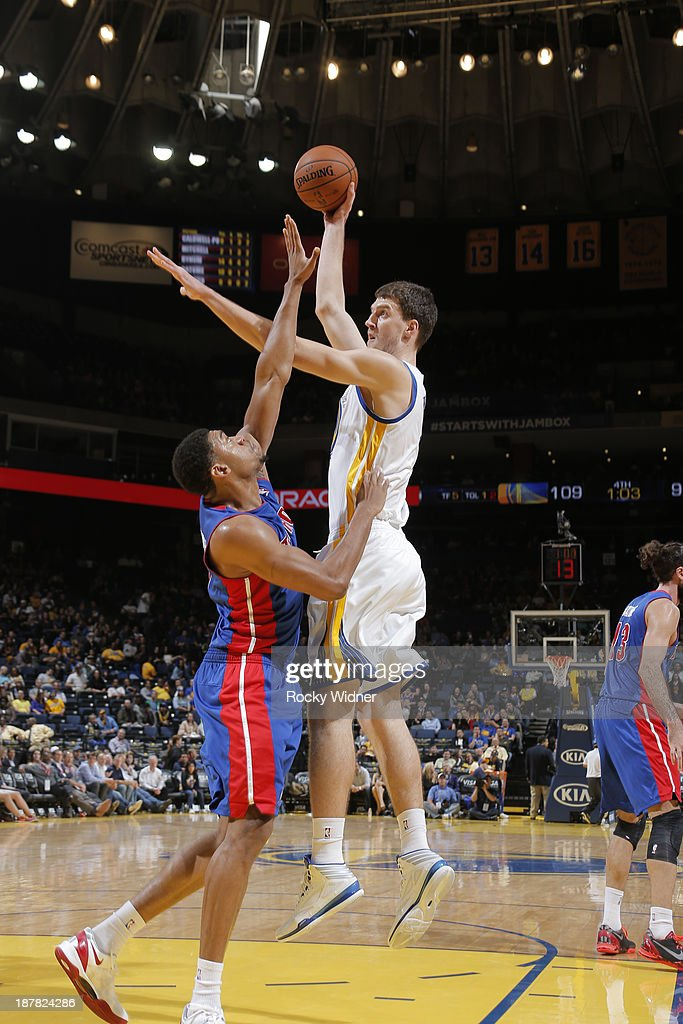 Ognjen Kuzmic #1 of the Golden State Warriors shoots against Tony Mitchell #9 of the Detroit Pistons on November 12, 2013 at Oracle Arena in Oakland, California.