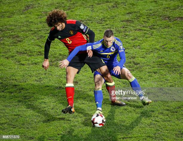 Ognjen Vranjes of Bosnia in action against Marouane Fellaini of Belgium during the FIFA 2018 World Cup Qualifier between Bosnia and Herzegovina and...