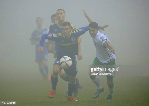 HERZEGOVINA NOVEMBER 13 Ognjen Vranjes of Bosnia in action against Robbie Brady of Ireland during the EURO 2016 Qualifier PlayOff First Leg match at...