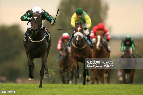 Ogre ridden by Jimmy Quinn wins the Buccoo reef Premier Claiming Stakes