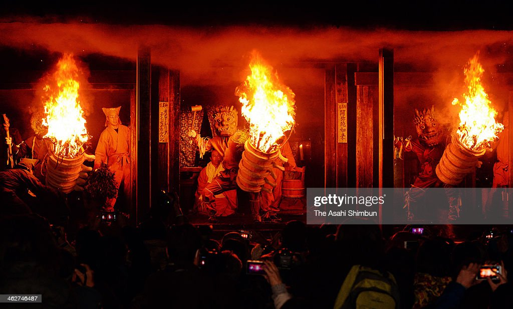 Ogres holding flaming torches pose the corridor of Dadado, or Dada hall during the Dadado-no-Oni-Hashiri ritual at Nenbutsuji Temple on January 14, 2014 in Gojo, Nara, Japan. The annual event held on January 14 every year, has more than 500 years history, is known as a rare ritual the orges are not symbols of evil, but as the ones to give fortunes and hapiness.