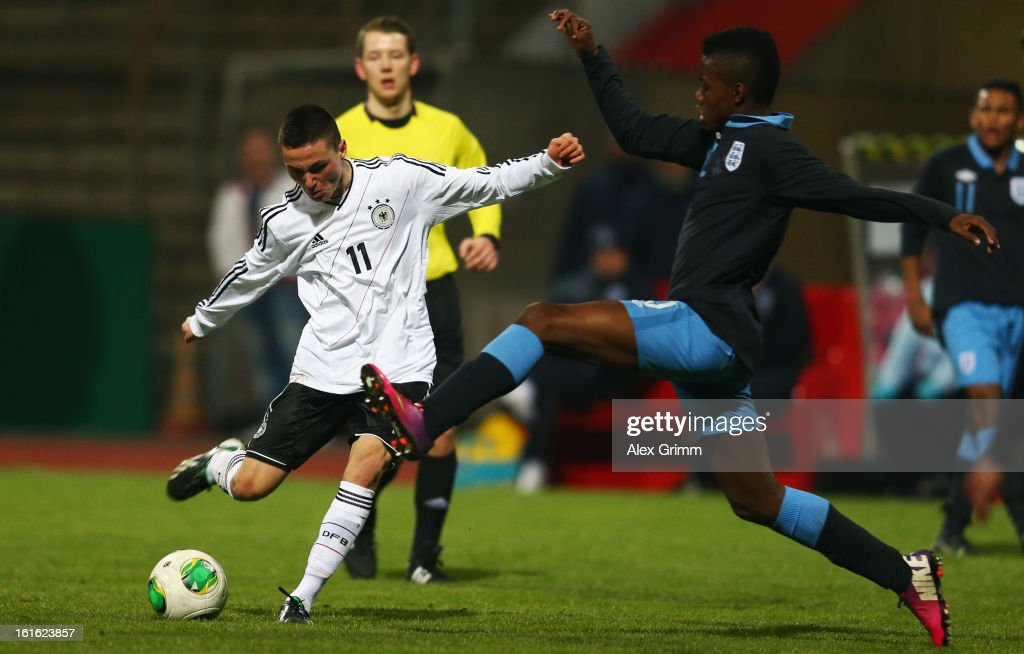 Oguzhan Aydogan (L) of Germany tries to score against Joshua Onomah of England during the U16 international friendly match between Germany and England at Suedstadion on February 13, 2013 in Cologne, Germany.
