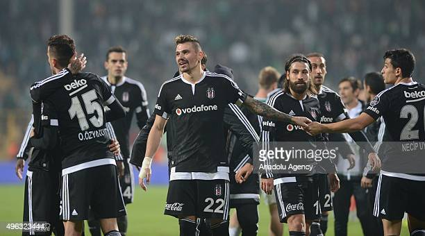 Oguzhan Ozyakup and his team mates celebrate the victory after the Turkish Spor Toto Super League football match between Bursaspor and Besiktas at...