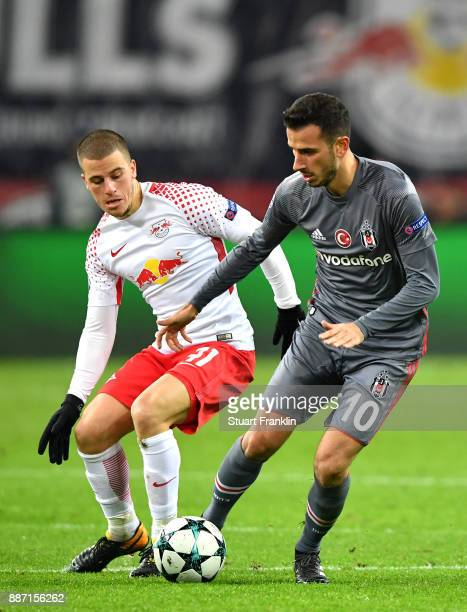 Oguzhan Ozyakup of Besiktas is challenged by Diego Demme of RB Leipzig during the UEFA Champions League group G match between RB Leipzig and Besiktas...