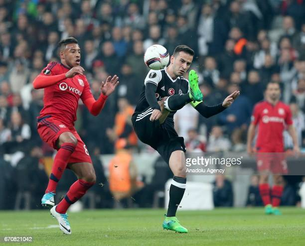 Oguzhan Ozyakup of Besiktas JK is in action against Corentin Tolisso of Olympique Lyonnais during the UEFA Europa League quarter final second match...