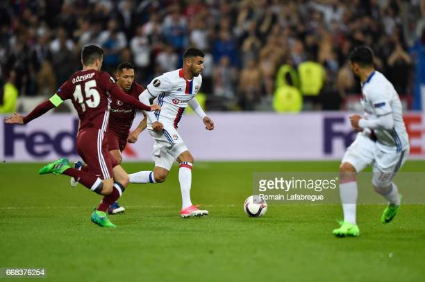 Oguzhan Ozyakup of Besiktas Rachid Ghezzal of Lyon during the Uefa Europa League quarter final first leg match between Olympique Lyonnais Lyon and...