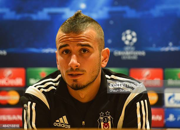 Oguzhan Ozyakup of Besiktas talks to the media during a press conference at Emirates Stadium on August 26 2014 in London United Kingdom