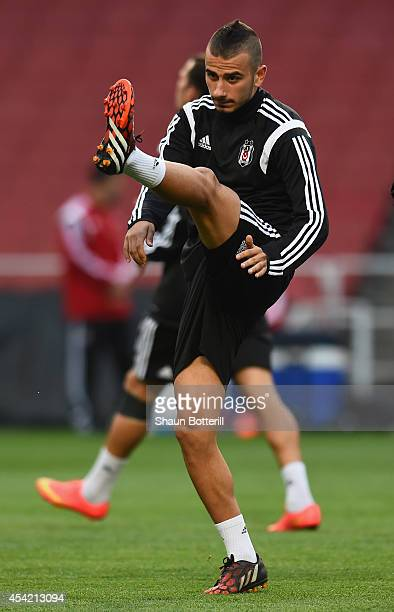 Oguzhan Ozyakup of Besiktas warms up during a training session at Emirates Stadium on August 26 2014 in London United Kingdom
