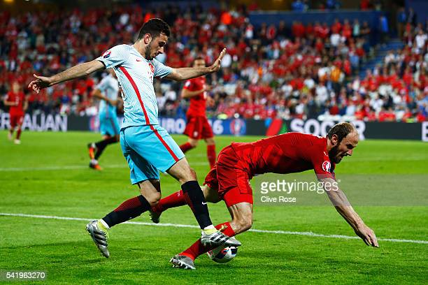 Oguzhan Ozyakup of Turkey tackles Roman Hubnik of Czech Republic during the UEFA EURO 2016 Group D match between Czech Republic and Turkey at Stade...